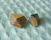 Olive wood studs, cut and decorated by hand, solid silver setting