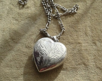 Silver necklace with large heart locket pendant