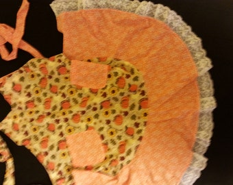 Frilly apron with pumpkins.  Perfect for Fall