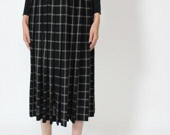 20% OFF! floor to ceiling windowpane pleated midi skirt