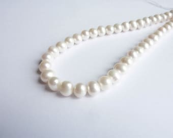 Ivory pearls 7-8mm wire on P0150