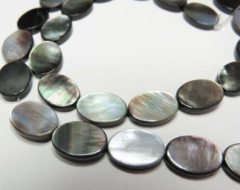 "Black Lip Shell Flat Oval Beads. 10 x 14mm. 16"" Strand."