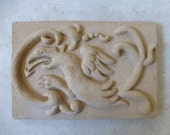 Dragon. Clay dragon. Bas-relief. Ceramic tile. Fireclay dragon. Gothic. Medieval. Chimeras. Wall hanging.