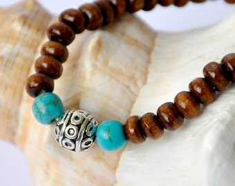 Beaded wooden bracelet with tibetan silver bead and turquoise beads