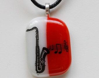 Fused, Glass, Pendant, - Saxophone, enamel decal - white, and dark burnt orange glass