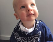 Toddler ajustable bandana with blue or red Paisley print and super soft minky back.