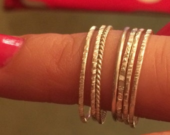 Ultra thin hammered stacking rings.  Set of 7. Size 7