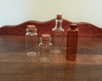 4 Mini Glass Bottles