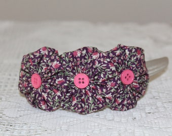 Tan Thick Solid Headband with Large Purple/Pink Yoyo Flowers