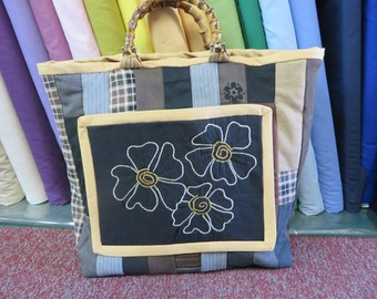 Heavy surge and wool carry-all bag using black, brown, beige and cream colours