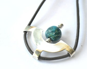Pendant of silver and blue stone