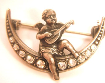 Brooch Victorian style angel with a lute on the crescent