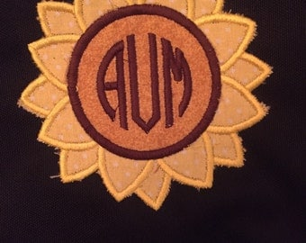 Jansport backpack with sunflower monogram applique