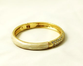 Gold-tone ivory with clear crystals