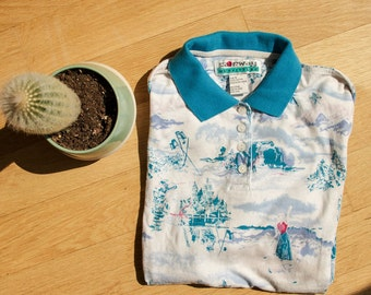 Vintage Blue and White Polo with Skiing Graphic