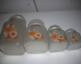 Frosted glass vintage canisters; set of 4