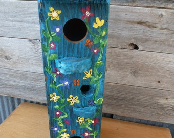 3 birdhouses with vines of flowers