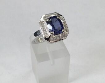 14k white gold oval tanzanite and diamond ring