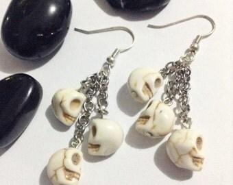 Dangly skull earrings