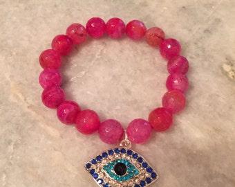 Pink w/ silver evil eye