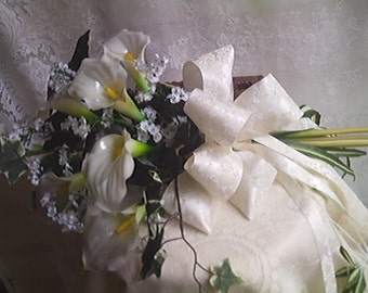 White real touch calla lillies..babies breath...arm bouquet