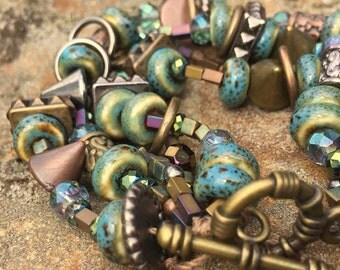 "Deep Waters Bracelet // 4 strand, turquoise, aqua, hematite, copper, bronze, metals, key, 7 1/2"" > blue silver"