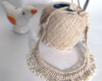 Necklace handmade using crochet with beige thread and pearl like white beads