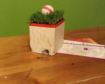 Paperweights, bookends with golf ball with synthetic grass on wooden base