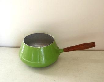 Vintage retro bright green fondue pot with wooden handle