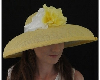 Lemon downturned brimmed hat trimmed with an ivory satin band, citrusy yellow and ivory handmade flowers