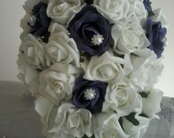 Cadburys purple and ivory or white Teardrop Bouquet using foam roses