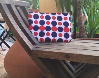 Red and blue polka dot clutch bag