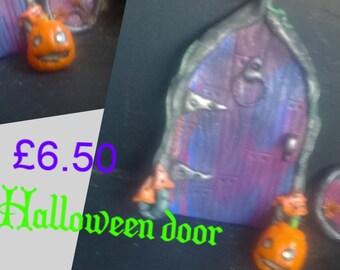halloween fairy door with glow in the dark pumpkin