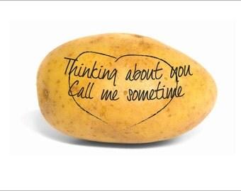 Hand written message on a Potato