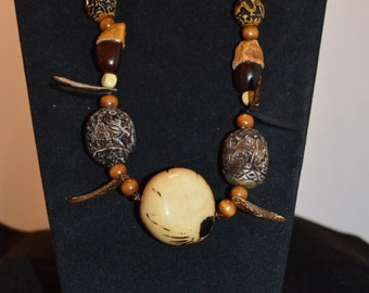 Resin Bead Necklace with Tauga Shell Center