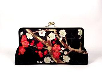 Cherry blossoms in black clutch purse