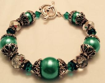 Teal swarovski and colored pearl bracelet