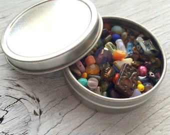 Glass beads - mostly czech glass beads in  2.5 inch aluminum tin over 85 grams
