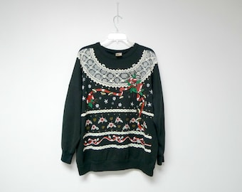 CHRISTMAS LACES . 1980s puffy print . black ugly sweatshirt . large . made in USA