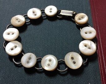 SALE! Teeny mother of pearl button bracelet