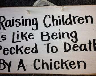 Raising children like being pecked to death by chicken sign wood plaque wall decor funny Trimble Crafts black red white