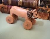 Fun decorative wooden lion toy on wheels