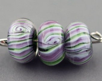 Purple green and white striped handmade glass lampwork bead set.