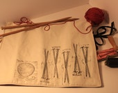 knitting themed needle roll, red and black, block printed