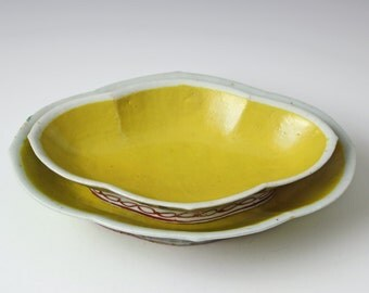 A pair of vintage Chinese porcelain bowls Famille Rose with flowers in yellow ground