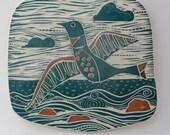 flying seabird hand carved ceramic art tile