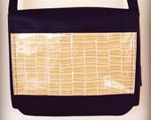 Cross body small satchel styled bag in orange pyramids