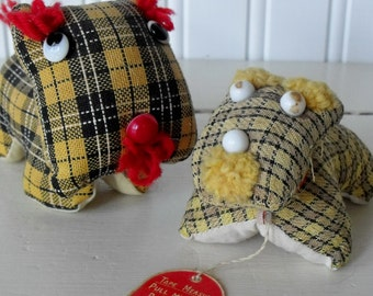 Pair of vintage dog pincushions, one with a tape measure, made in Japan