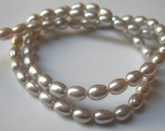 15 Inch Strand of Fresh Water Silver oval Pearls  5 -5.5mm beads