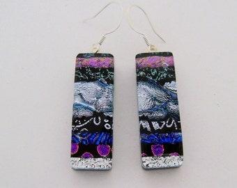 Dichroic glass dangle earrings.